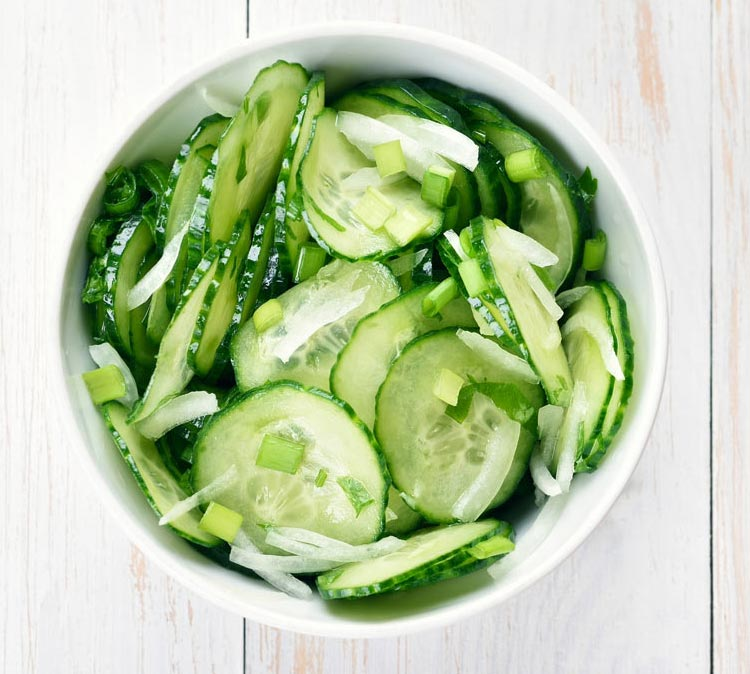 Combine cucumbers, onions, celery, and stevia to make a healthy cucumber salad.